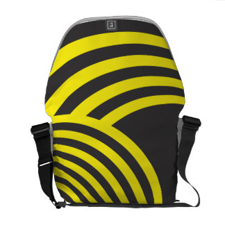Yellow and black sphere and hole illusion messenger bag