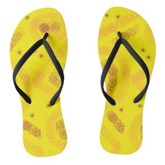 Yellow arty design flip flops
