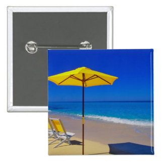 Yellow beach umbrella and chairs on pristine 15 cm square badge