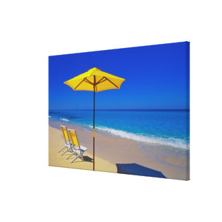 Yellow beach umbrella and chairs on pristine canvas print