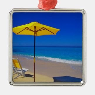 Yellow beach umbrella and chairs on pristine christmas ornament