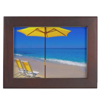 Yellow beach umbrella and chairs on pristine keepsake box