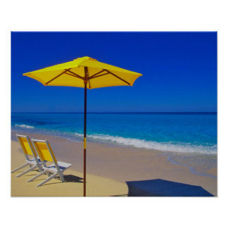 Yellow beach umbrella and chairs on pristine print