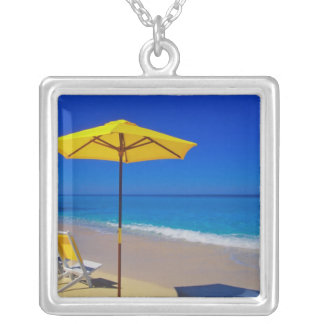 Yellow beach umbrella and chairs on pristine silver plated necklace