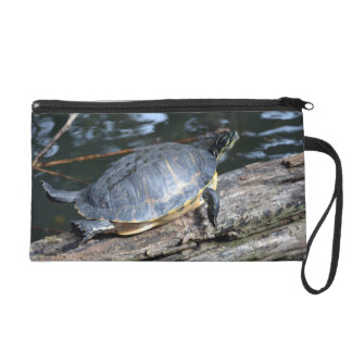 yellow belly slider sunning self on log wristlet clutch
