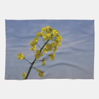 Yellow Crop Flower on Blue Sky background Tea Towel