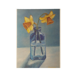 Yellow daffodils in a blue vase wood poster