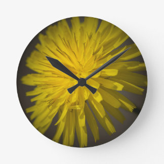 yellow dandelion in the meadow wall clock
