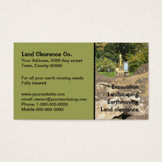 Yellow digger behind rocks business card