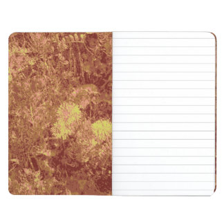Yellow flower against leaf camouflage pattern journals