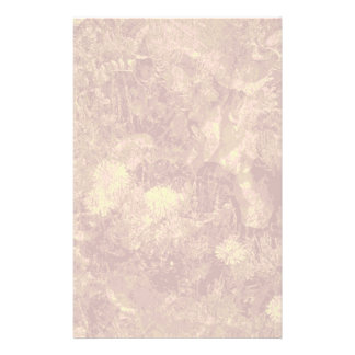 Yellow flower against leaf camouflage pattern stationery