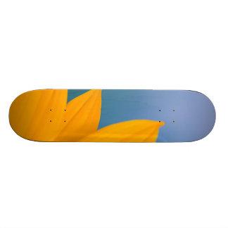Yellow Flower on Blue background Skateboard Decks
