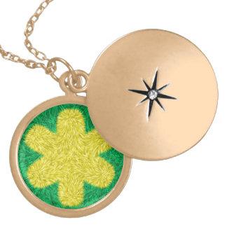 Yellow flower on green background round locket necklace