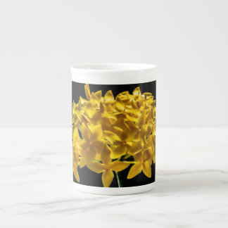 YELLOW FLOWER ON TEA CUP