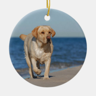 Yellow labrador retriever on the beach round ceramic decoration