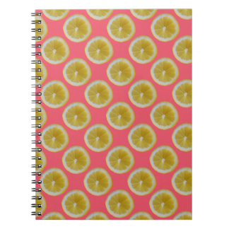 Yellow lemon slices on pink notebooks
