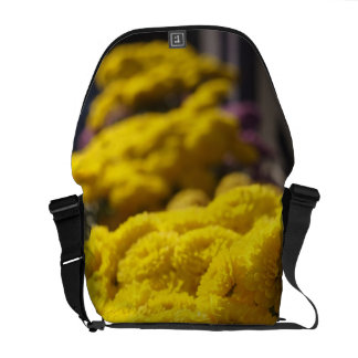 Yellow marigolds bask in sunlight courier bag