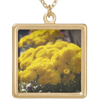 Yellow marigolds bask in sunlight square pendant necklace