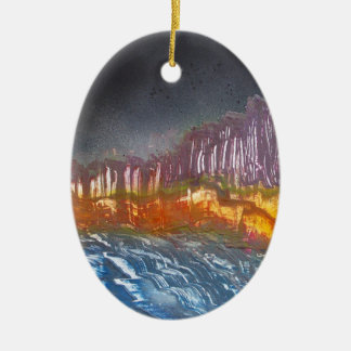 Yellow moon over metamorphic landscape christmas ornament