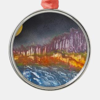 Yellow moon over metamorphic landscape christmas ornament