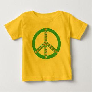 Yellow/orange floral on green peace symbol shirt