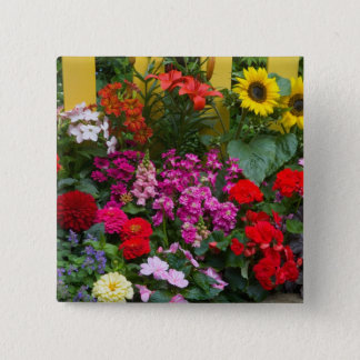 Yellow picket fence with flower garden in 15 cm square badge