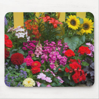 Yellow picket fence with flower garden in mouse mat