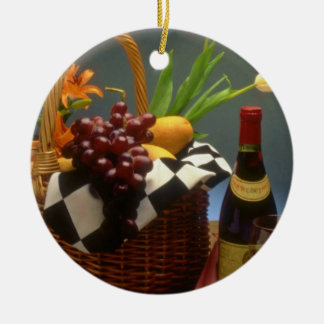 Yellow Picnic basket with wine, cheese, bread and Christmas Ornament