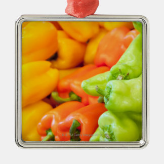 Yellow, red and green pepper on sale at farmer's christmas ornament