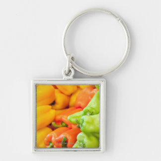 Yellow, red and green pepper on sale at farmer's key ring
