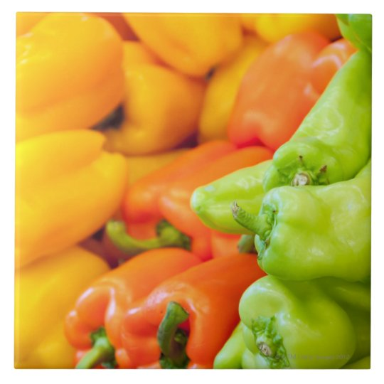Yellow, red and green pepper on sale at farmer's large square tile