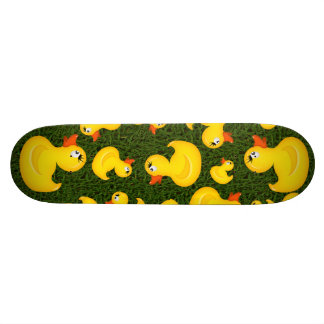 Yellow Rubber Ducks on Green Grass Skateboard