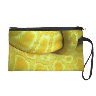 Yellow snakeskin wristlet