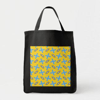 yellow snowboard pattern tote bag