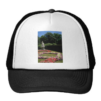 Yellow Statue and flower beds - The Elms U S A f Trucker Hat