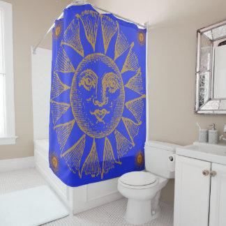 yellow sun on blue shower curtain