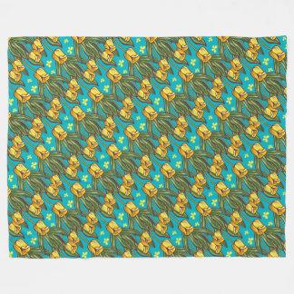 Yellow tulips on a blue background fleece blanket