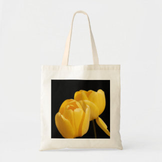 Yellow Tulips On Black Bakground Tote Bag