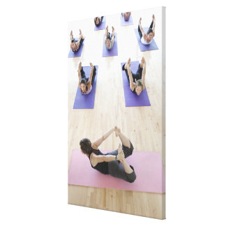Yoga instructor leading class through the 2 canvas print