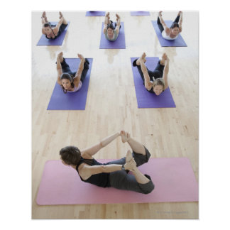 Yoga instructor leading class through the 2 poster