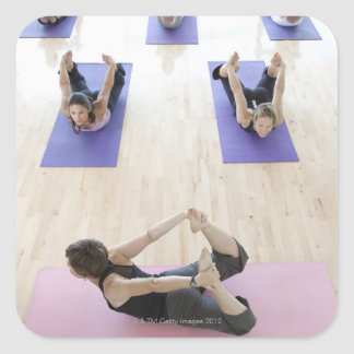 Yoga instructor leading class through the 2 square sticker