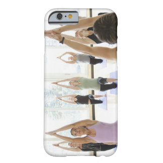 Yoga instructor leading class through the barely there iPhone 6 case