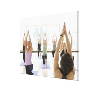 Yoga instructor leading class through the gallery wrap canvas
