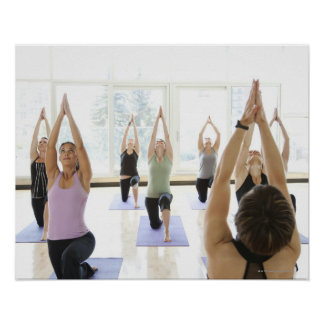 Yoga instructor leading class through the poster