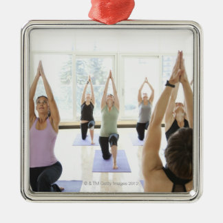 Yoga instructor leading class through the Silver-Colored square decoration