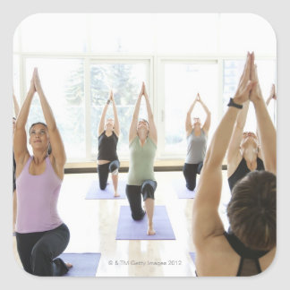 Yoga instructor leading class through the square sticker