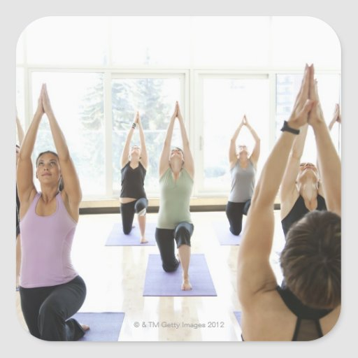 Yoga instructor leading class through the sticker