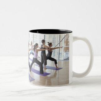 Yoga instructor teaching a class of women the Two-Tone coffee mug