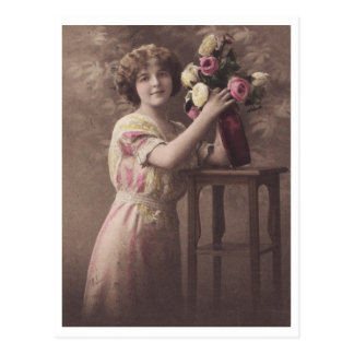 Young Beautiful Romantic Woman and Vase of Flowers Postcard