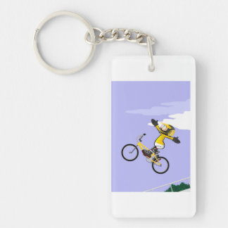 Young BMX flying by in the air with its bicycle Key Ring